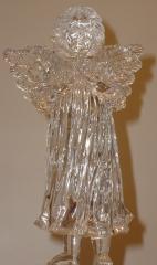 Anjo de acrílico com base luminosa.