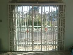 Pantografica e porta de vidro