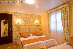 Apartamento triplo (camas individuais)