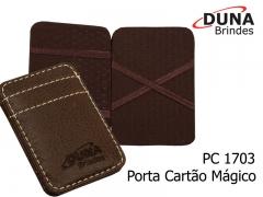 Porta cartão mágico pc 1703 - encaixe o cartão de um lado e ele aparece do outro. confeccionado em couro legítimo, couro sintético ou couro ecológico (recouro). personalizado com seu logotipo em baixo relevo.